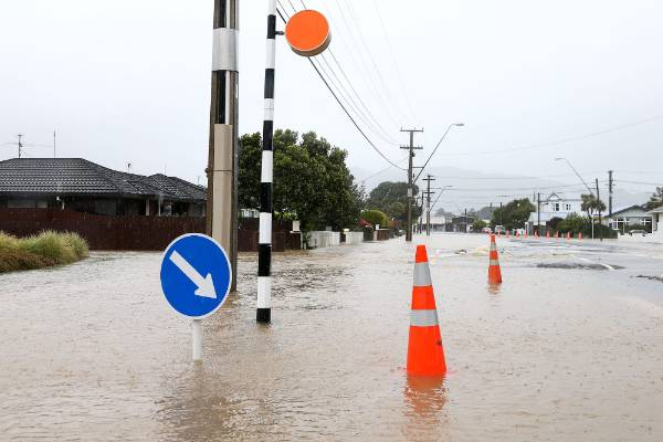 Flood water covers the road surface on Udy Street, Petone.
