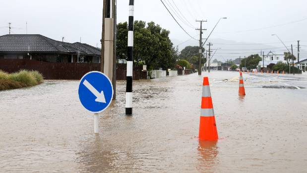 There's no getting through here. Flood water covers the road surface on Udy Street, Petone, Wellington.