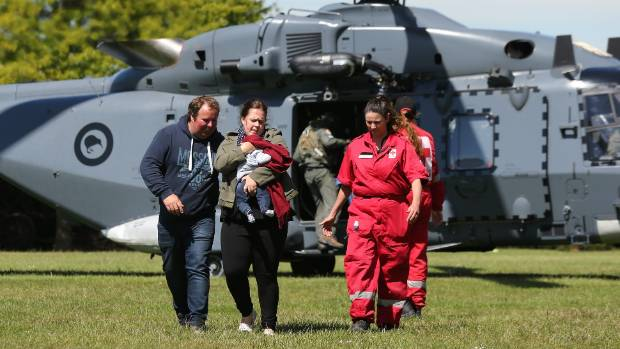 Tourists trapped by the Kaikoura earthquakes arrive by military helicopters at Woodend School grounds.