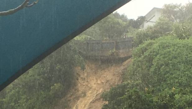 A house is teetering at the top of this large slip in Paramata, Wellington.