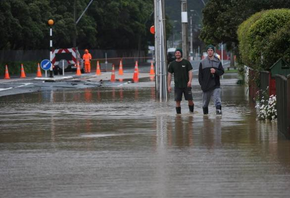 Wading through the waters in Udy St, Petone.