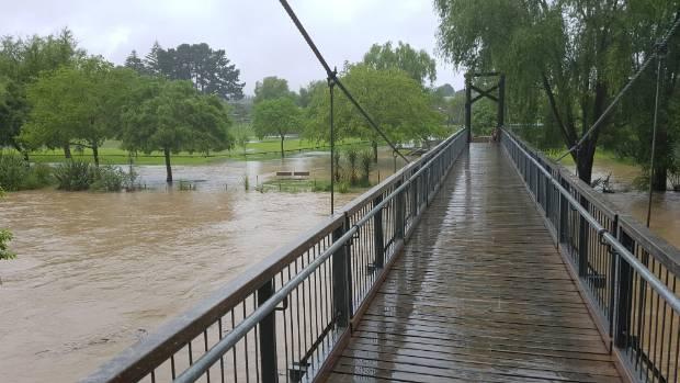 The footbridge over the Waikanae River, on the Kapiti Coast, looking towards the Otaihanga Domain, which has been closed ...