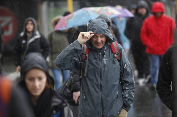 Commuters returned to Wellington's CBD following yesterday's earthquakes but had to brave gale force winds and rain.