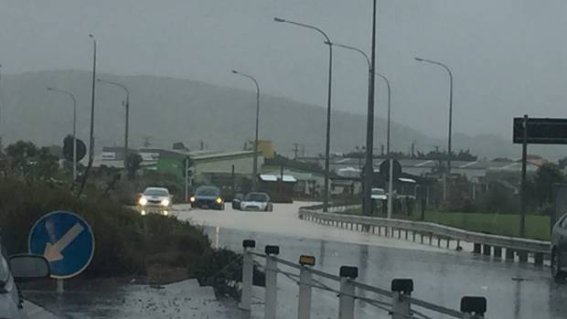 Floodwaters covered the highway at the roundabout, just north of Plimmerton.