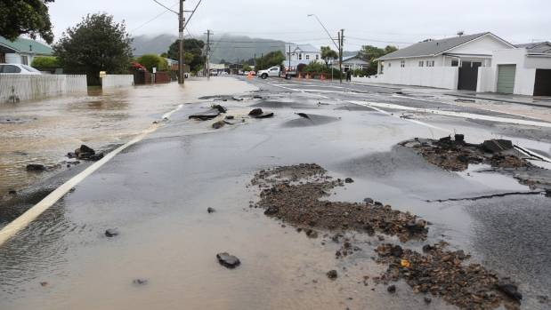Flooding in Udy St, Petone, which was also damaged by the 7.5 earthquake.