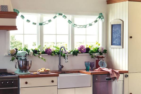 Greenery and paper chains on a windowsill will subtly bring Christmas to your kitchen.