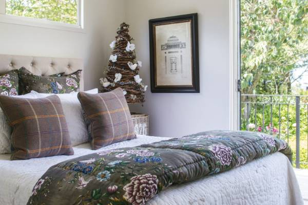 For those short on space or living in share housing, a Christmas tree on the bedside table will keep you in the ...
