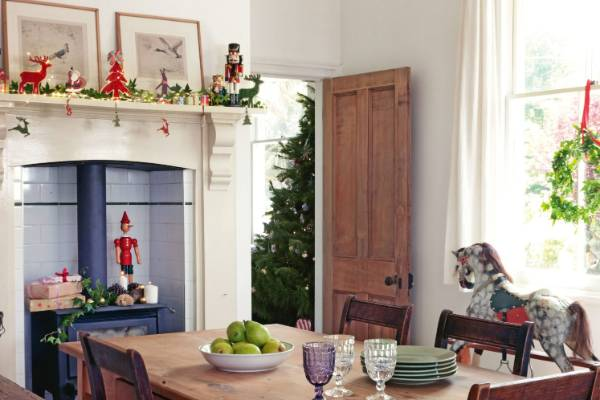 nutcrackers christmas greenery and fairy lights on the mantelpiece will subtly fill your home with - Decorating Your House For Christmas