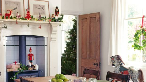 Nutcrackers, Christmas greenery and fairy lights on the mantelpiece will subtly fill your home with holiday cheer ...