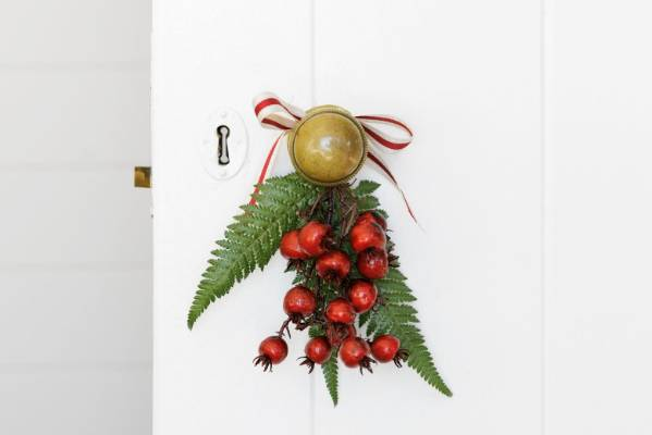 Or, if you want to be a little more creative, tie a bunch of mistletoe to a doorknob with some festive ribbon.