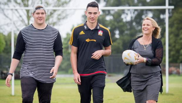 Year 12 student, Matt Ogilvy, Chiefs rugby player Shaun Stevenson and event co-ordinator for Graeme Dingle Foundation, ...
