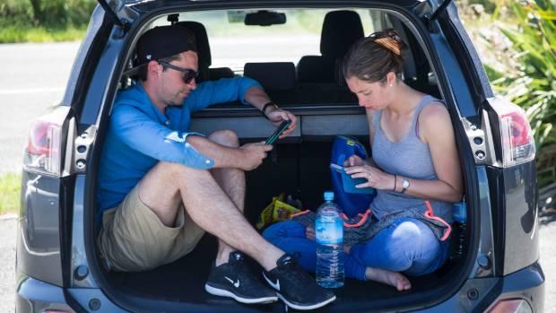 Stranded honeymooning tourists Eddie and Leslie-Anne Llewelyn-Evans wait at Kaikoura airport.