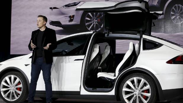 Sexy and virtuous: Tesla Motors CEO Elon Musk introduces the falcon wing door on the Model X electric sports-utility ...
