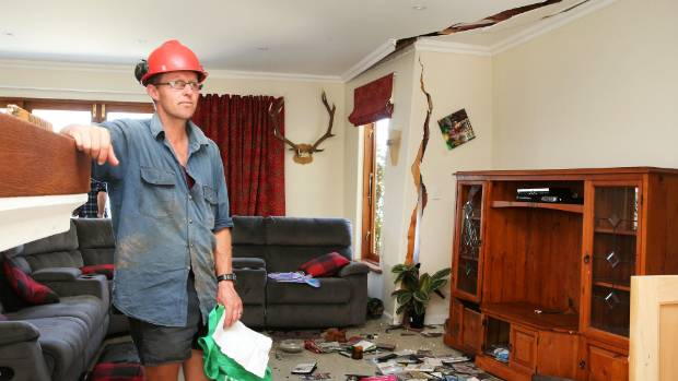 Kaikoura farmer Duncan Furniss inspects the damage to his dream home that is now condemned after Monday's 7.5 magnitude ...