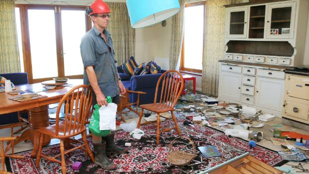 Duncan Furniss inspects the damage to his Kekerengu Road home near Kaikoura. It is now condemned after Monday's 7.5 ...