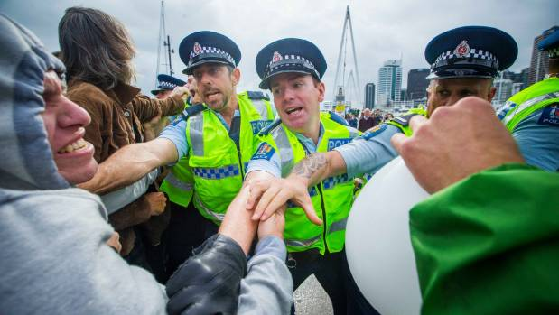 Activists and police officers have clashed outside a military conference being held in downtown Auckland. About 100 ...