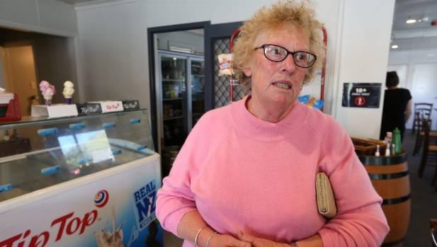 Ward resident Mavis Booker stops at the Cosy Corner Cafe to pick up a hot meal.