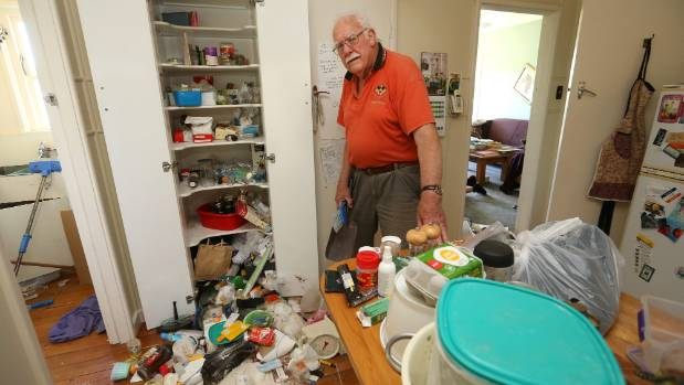 Vince Smith helps clean up his daughter's house in Seddon.