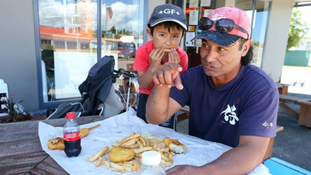 Seddon residents Lyuta Kumasaka, 5, left, and his father Richard Ronaki take a break from the clean-up.