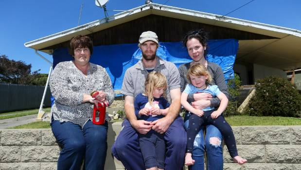 The Pope family, from left, Susan, Nick, Issie, 5, Jess Barrow and Mollie, 2, are cleaning up after the earthquake.