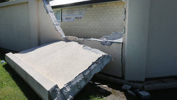A concrete wall and bricks have toppled in Seddon.