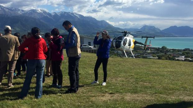 A group of Chinese tourists waits to be flown out of the quake zone.