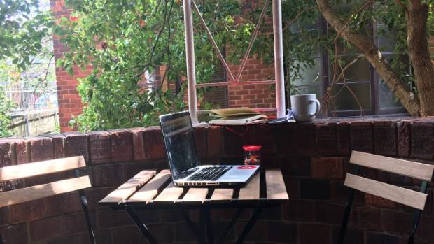 The balcony of Sutherland's home in Sydney, with the Macbook she says she can't live without.