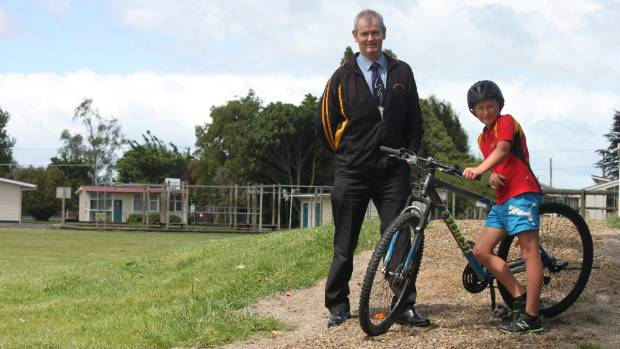Principal James Eldridge and Thomas Pilmore-Evans on the almost-completed Firth Primary School cycle track.