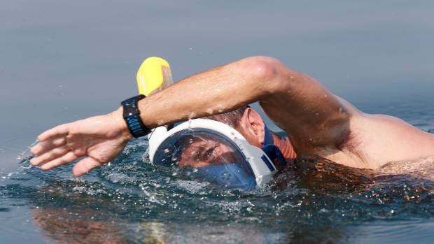 "An environmental activist takes part in ""The Dead Sea Swim Challenge""."