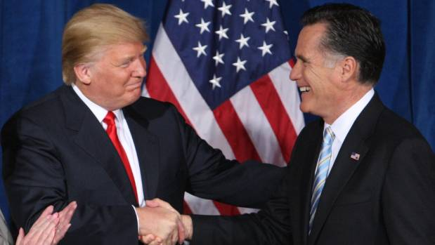 President-elect Donald Trump greets former Massachusetts Governor Mitt Romney in February. Romney could be Trump's new ...
