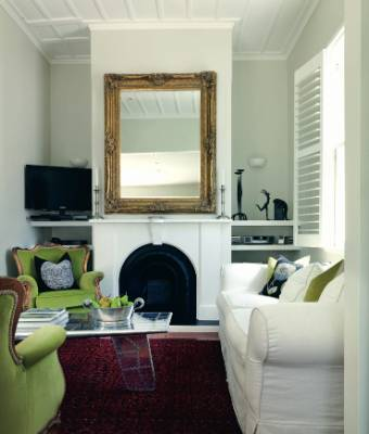 A decorative mirror can be a replacement for art on a bare wall.
