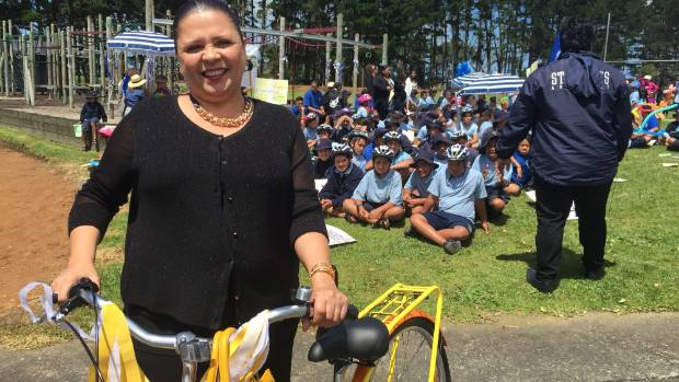 Principal Geraldine Malgas joins her students and shows off her new yellow bike.