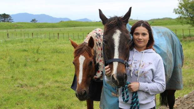 Fibromyalgia patient Laura Mabey with her horses, Red and Otto.