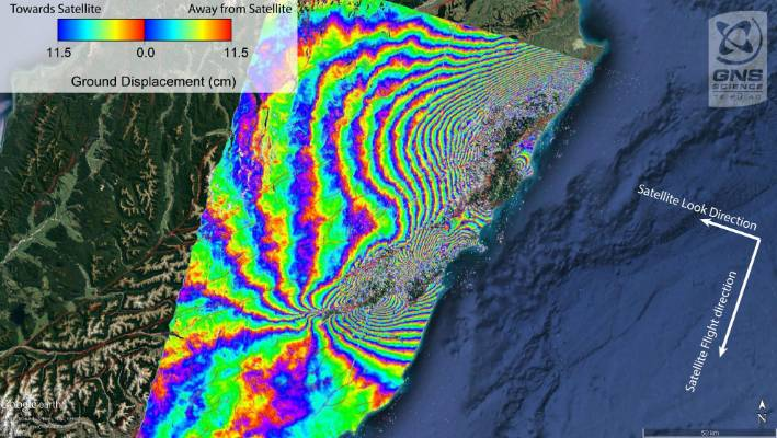 This image is an interferogram, produced using data from a Japanese Space Agency satellite.  Each set of rainbow-coloured contours represent 11.5cm of movement. Where the coloured contours are closest together is where the largest changes in land motion are occurring.