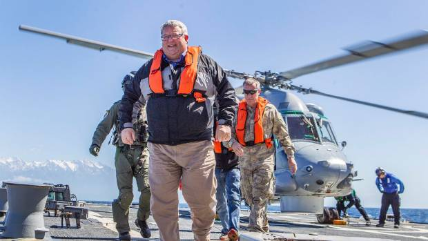 Gerry Brownlee lands on board the USS Sampson during its visit to Kaikoura following the November earthquake.
