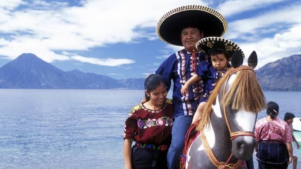 A local family saddle up on the coast of Lake Atitlan, Guatemala.