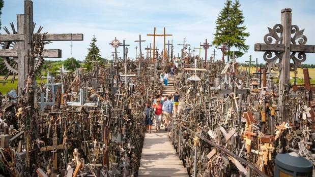 Pilgrims visiting the Hill of Crosses, Lithuania.