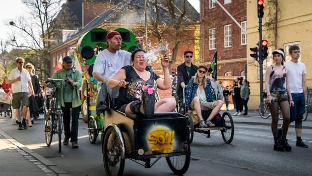 A parade in Christiania, Copenhagen, Denmark, with ''Canabis Cures Cancer'' as a main theme.