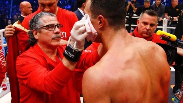 "Jacob ""Stitch"" Duran works on the right eye of Wladimir Klitschko following the heavyweight champion's surprise loss to ..."