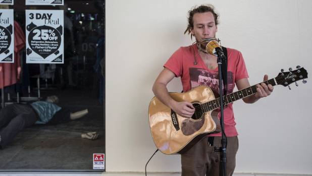Busker Bram Jansen, outside the damaged Farmers building, has been travelling New Zealand for three months and said Cuba ...