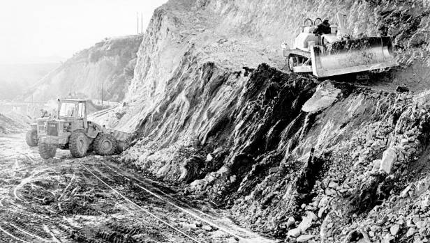 Ministry of Works bulldozers ripping away part of the hillside on bends between Claverley and Hundalee in 1982 so a more ...