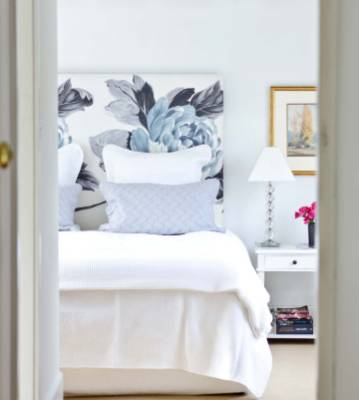 This main bedroom features designer fabric on the bedhead, which gives this neutral room some visual interest.