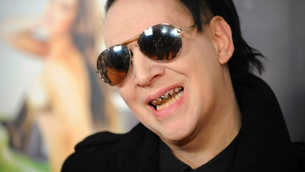 Marilyn Manson and Justin Bieber are embroiled in a bizarre feud that began over T-shirts.