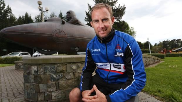 Motocross legend Josh Coppins at the Burt Munro statue at Queens Park in Invercargill.
