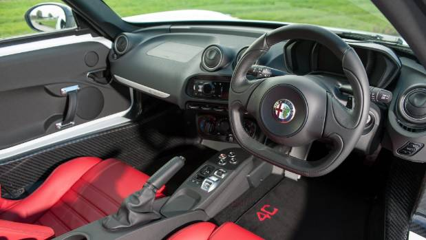 Serious rather than swish: racing-style dashboard and lots of exposed carbon fibre in cabin.
