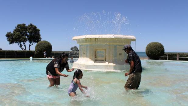 Napier's Walker family - Geraldine, Galaxy Rose, 5, and Bob Walker - cooling down in the city's Tom Parker Fountain on ...