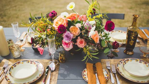 Rambling table bouquets are complemented with artisan details for a romantic look.