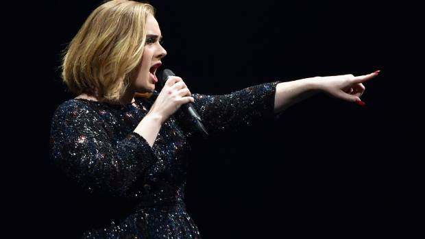Singer Adele performs on stage at The O2 Arena in London.