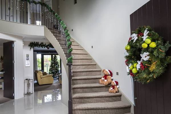 A warm and inviting front door begins the Christmas story.