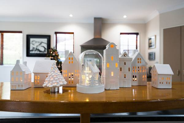 A model Christmas village glows with the promise of good times ahead.